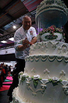 figure: Special guest and cake decorating artist David MacCarfrae creating